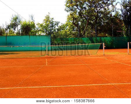 Tennis court during sunny day in sport areal