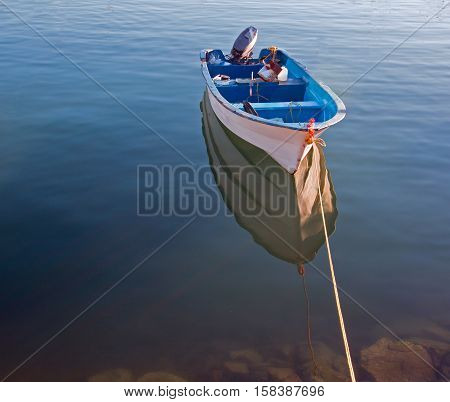 Small Fishing Boat at dawn in Cabo San Lucas marina
