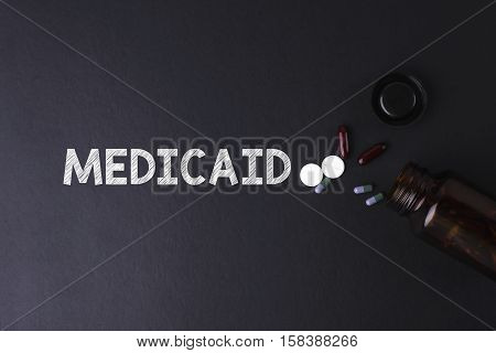 Medicaid Word With Medicine And Bottle - Health Concept. Medical Conceptual.