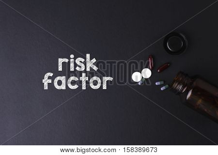 Risk Factor word with medicine and bottle - Health concept. Medical conceptual