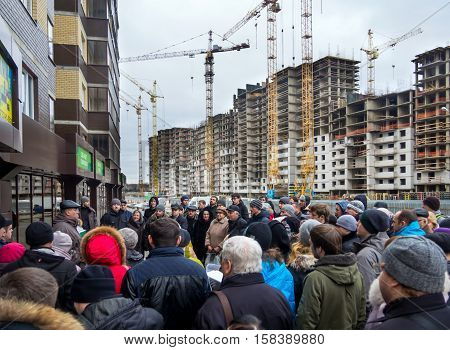 Voronezh, Russia - December 20, 2015: Meeting people at the construction site of a new home