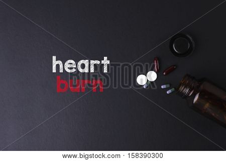 Heart Burn Word With Medicine And Bottle - Health Concept. Medical Conceptual.