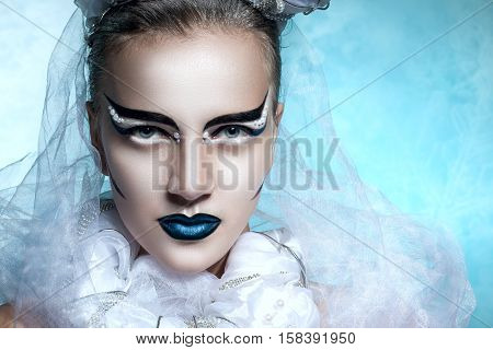 Winter Portrait Of A Woman With Creative Makeup. Snowy Beauty. Flawless Makeup, Perfect Shape. Cold