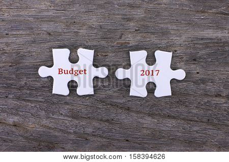 Missing white puzzle with positive Budget 2017 and copyspace area