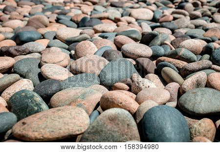 a sea of rocks fill the shorelines of Lake Superior