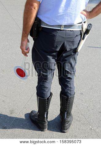 Policeman With Boots On The Street In Checkpoint