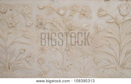 AGRA, INDIA - FEBRUARY 14 : Mughal stone art on the facade of the Taj Mahal (Crown of Palaces), an ivory-white marble mausoleum on the south bank of the Yamuna river in Agra on February, 14, 2016.