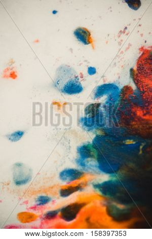 Whirlwind vortex spreads colored ink colors on white background. Abstractly spreads dye ink red, green, yellow, orange, blue background on paper. Art Creative abstract background. Colorful background