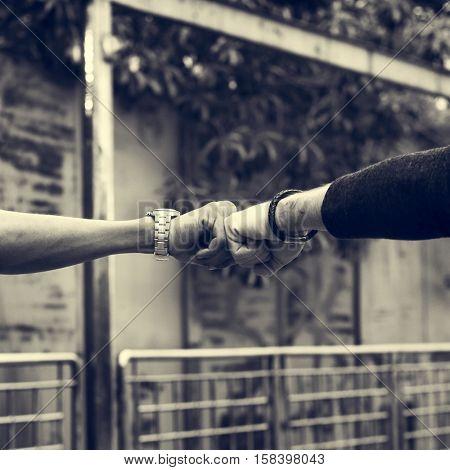 Fist Bump Partnership Friendship Concept