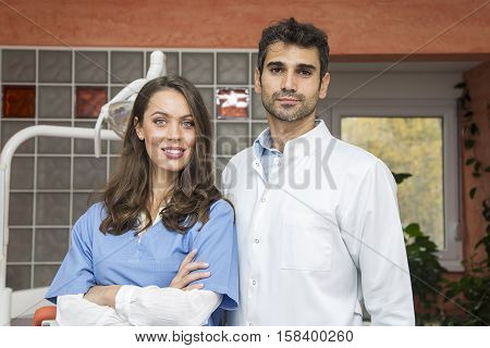 Young male and female doctors posing in the dentist office