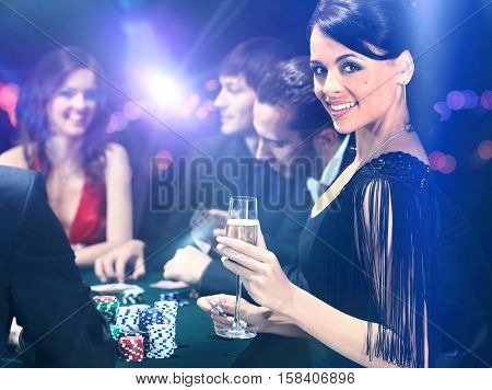 Poker players sitting in casino