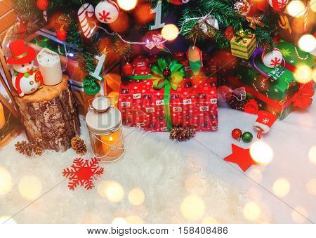 Christmas tree background and Christmas decorations with snow giftsblurred sparking. Happy New Year card. Winter holiday and Xmas theme