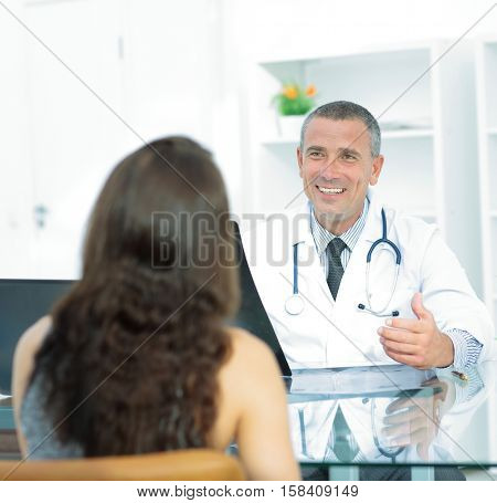 at the reception, the therapist discusses with the patient the r