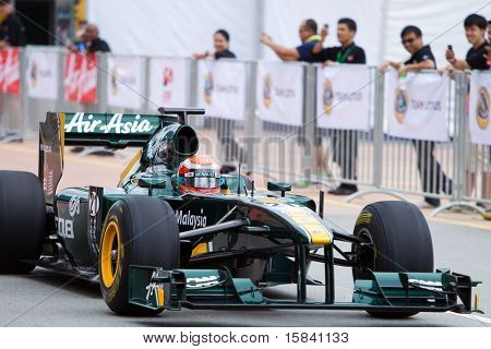 Trulli speeds down the straight at an F1 demo run