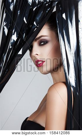 Magic Eyes Look Beautiful With Bright Makeup. A Girl Looks Through The Veil