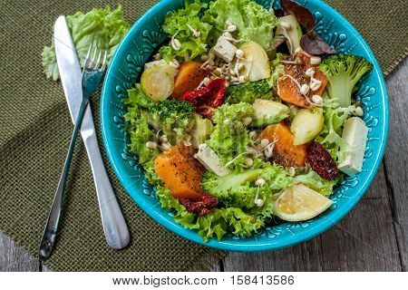 Salad with sweet potatoes, dried tomatoes, avocado, broccoli, brussels sprouts, tofu, mung bean sprouts. Perfect for the detox diet or just a healthy meal.  Love for a healthy raw food concept.