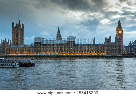 LONDON, ENGLAND - JUNE 16 2016: Sunset view of Houses of Parliament, Westminster palace, London, England, Great Britain
