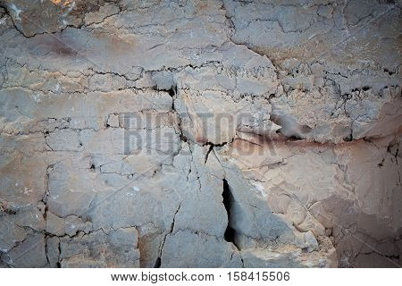 Massive stone white color with cracks on the surface