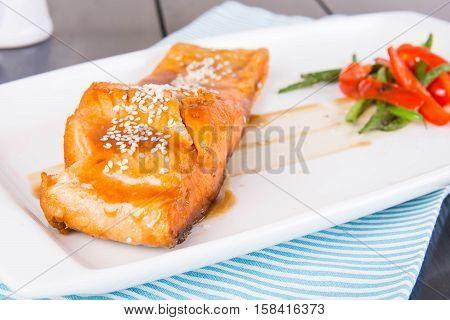 pan fried salmon in a dash of teriyaki sauce