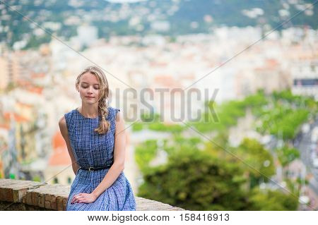 Girl Looking At The City Of Cannes