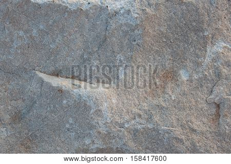 Massive stone white with irregularities on the surface
