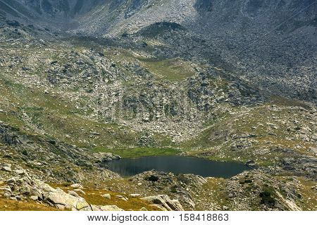 Rocky scree and Spanopolsko Lake, Pirin Mountain, Bulgaria