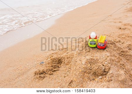 Two toy cars left the children on the beach