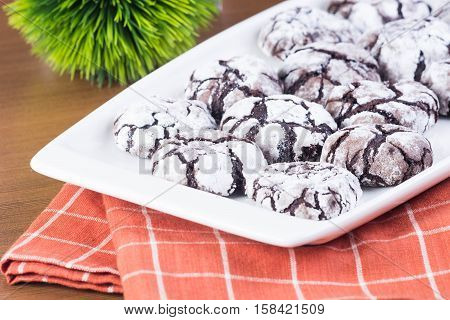 chocolate crinkles is a chocolate dough that is baked soft and covered with confection sugar