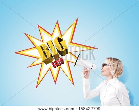 Woman With A Megaphone Near A Big Sale Poster On A Blue Wall