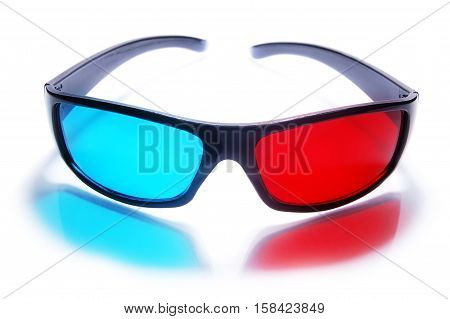 3d stereo anaglyph plastic glasses on a white background. 3d glasses create a red-blue reflection.