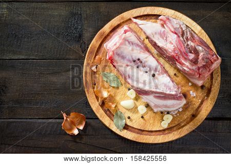 Salty Lard With Spices And Parsley On A Wooden Background. Top View, Copy Space.