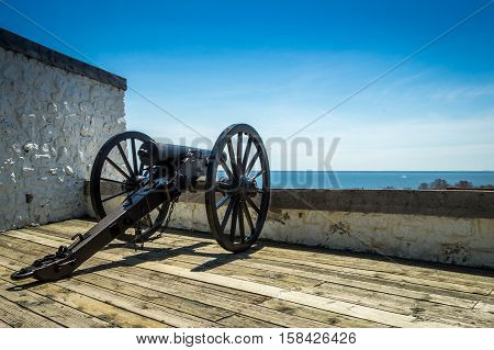 a cannon overlooks the lake at Fort Mackinac