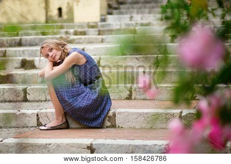 Beautiful Young Girl Sitting On The Stairs
