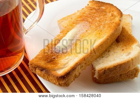 Hot Toast With Butter On A White Plate Close-up