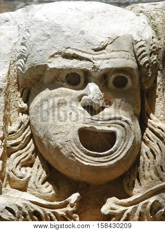 Stone mask - decoration ancient Roman theater in Demre. Turkey
