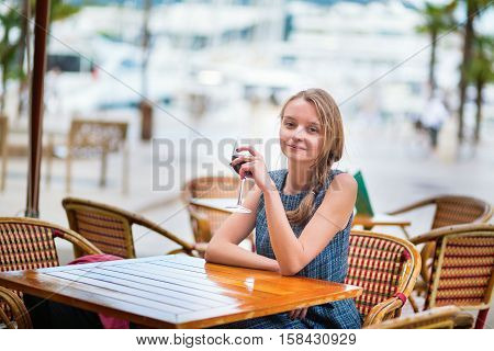 French Woman Drinking Red Wine
