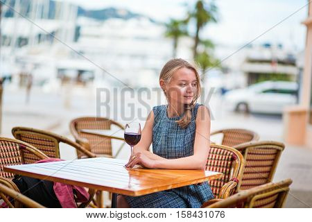 French Woman In An Outdoor Cafe Of Cannes
