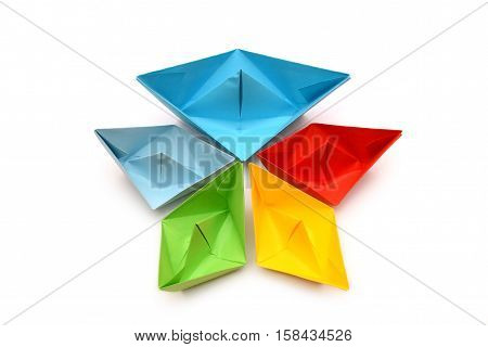 Colored paper boats, origami. Abstract paper design
