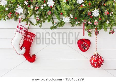 Christmas Background. Christmas Fir Tree, Christmas Socks And Decon White Wooden Board Background. T