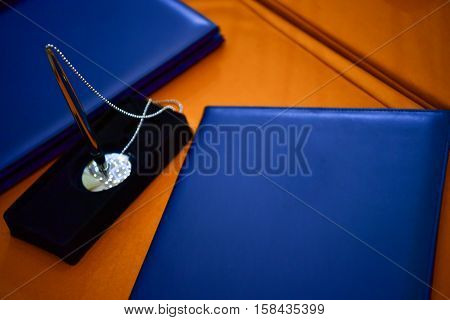 Blue notebook for signing agreement on cooperation.