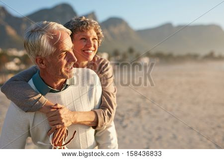 Senior Couple Enjoying Their Vacation At The Beach