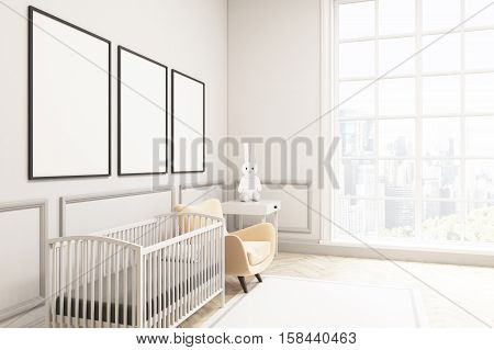 Side View Of A Baby's Room With A Hare And Three Vertical Posters