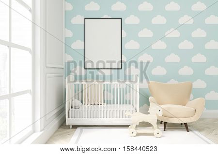 Close Up Of A Child's Room With Cloud Wallpaper On Blue Wall