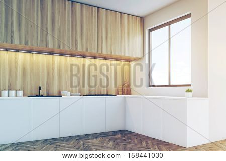 Corner Of A Kitchen Counter Top With Light Wood Furniture