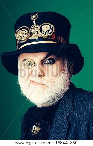 Bearded Man Looks Through Cogwheel