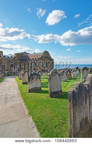 Whitby, UK - May 11, 2011: Whitby Churchyard and Cemetery in North Yorkshire in the UK. It is ruins of the Benedictine abbey. Now it is under protection of the English Heritage.