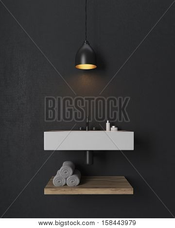 Bathroom interior. There is a large rectangular sink with a wooden towel shelf under it. Black lamp is hanging above. Black wall. 3d rendering.