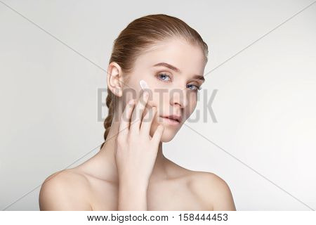Beauty portrait young woman healthy skin care health white background smile healthcare treatment copy space salve close up
