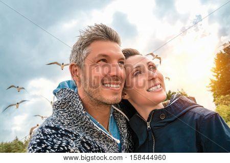 couple on the windy sea having fun