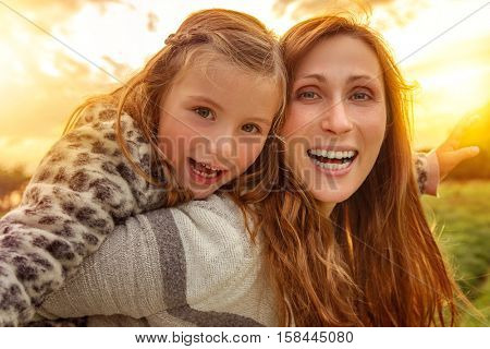 mother with daughter outdoors catching the sun